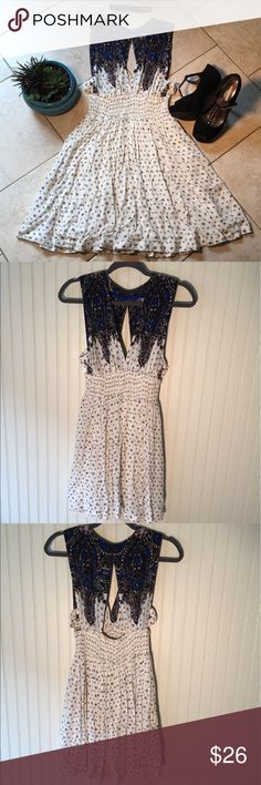 Free People Walking Through Dreams Dress FP dress with blue details. Deep V in front and back. Side cutouts with crisscrosses. Very comfortable and flowy. Never worn, took tags off after purchasing from FP store and it has sat in my closet since, so it's time to move on. Perfect condition! Free People Dresses