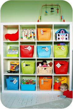 Colourful storage - I like the baskets! :) Now I just have to figure out where to find ones like this.
