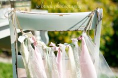 Use strips of delicate fabrics or ribbons as chair decorations for wedding ceremony seating or reception. #DIY #Wedding