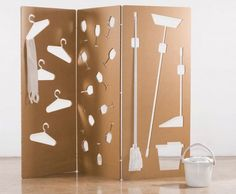 Sandra Cabello's Cardboard Wall Stores Everything from Brooms to Coffee Cups