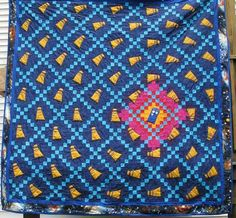 Truly excellent TARDIS quilt. A modified Irish chain pattern with Daleks swirling around the TARDIS.