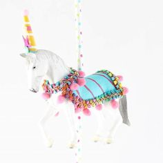It isn't a carnival party without a carousel horse! Carnival themed party cake topper