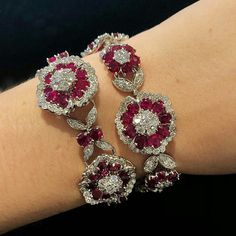 Featured here a wonderful pair of ruby and diamond bracelets by Van Cleef & Arpels from a set of 'Camelia' Jewellery. @christiesjewels