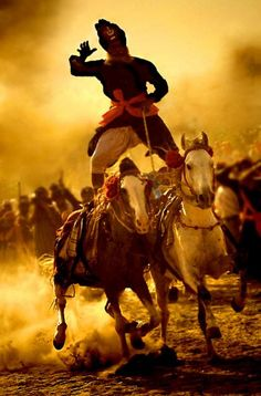 Holla Mohalla ~ Horsemanship considered apart of the Sikh Martial Arts called Gatka ~ The attire of this individual reflects the Sikh Warrior Attire from Ancient Times
