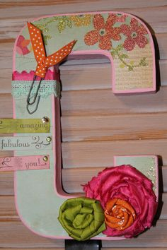 8 Decorative Letter with ribbon flowers via Etsy. Cute for a little girls  room!