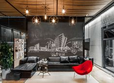 In this meeting room, rope has been used to cover the ceiling, while a chalkboard wall allows the space to be ever changing with the use of art. Click through to see more photos of this modern workplace. #ModernOffice #ModernWorkplace #MeetingArea #RopeCeiling #ChalkboardWall