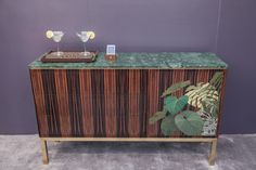 The cabinet is a luxurious yet understated focal piece
