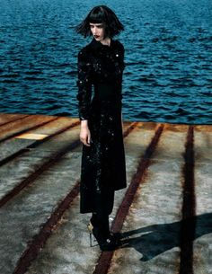 Model Agata Rudko by the stormy sea. Photo by George Katsanakis for Madame Germany August 2013