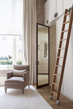 Great idea for dressing room - secret door into the bathroom.  This double height wardrobe, designed by Emily Todhunter of Todhunter Earle for a house in West London, has a secret. Disguised among the doors are the entrances to twin bathrooms and a dressing room.  From the June 2014 issue of House & Garden