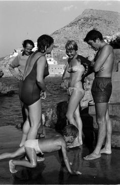 Leonard Cohen and Marianne with George Johnston, Charmian Clift and their son at the swimming rocks (spilia) Hydra 1950s