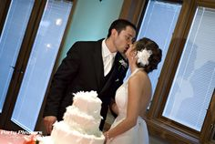 Couple kisses with cake. Pin spot on cake and teal uplight on wall  Photo Credit- Kim Greer  #CincinnatiWedding #PartyPleasers #Uplights #Pinspotlighting Voice Of America, Photo Credit, Kisses, The Voice, Photo Wall, Teal, Couples, Wedding Dresses, Cake