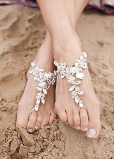 10 Ideas For Beach Weddings: #3. Barefoot sandals. While sandy beaches are beautiful to look at, they aren't exactly high heel friendly. Instead, add a touch of sparkle (and a lot of comfort) with crystal barefoot sandals.