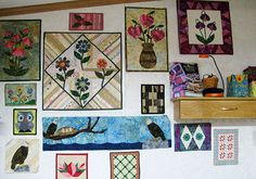 I really love the string quilt with the flowers appliqued