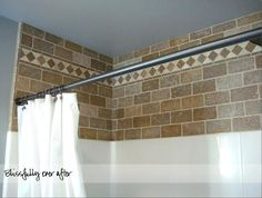 Add natural stone rule to area between wall tile and ceiling. Bathroom remodel at blissfullyeverafter.net