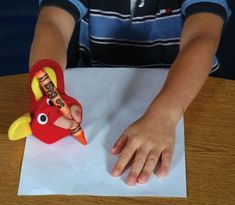 "The Ellie Grip is a ""sock"" for the hand to maintain correct pencil grip. The Ellie Grip has two holes for the index finger and thumb. The other fingers remain in the sock. Motor Skills Activities, Preschool Learning Activities, Fine Motor Skills, Preschool Activities, Kids Learning, Montessori, Handwriting Activities, Pencil Grip, Pre Writing"
