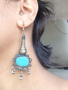 Blue Silver Earrings This light silver patri with a brilliantly torquoise blue stone was found in a quaint hut shop in old Khajurao streets. This is what treasure hunts are made of.
