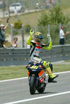 Rossi and Honda, celebrating another win.