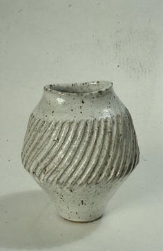Lucie Rie, Vase, stoneware, ova rim flecked grey overall, deep fluting in wide band around centre.