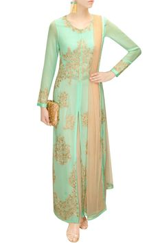 This light green kurta set featuring in silk georgette with resham floral work all over. This light green kurta set comes along with contrast peach georgette pa