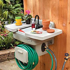 "So cool! I wish the hose would reel up too...it just looks like a holder even though they call it a hose ""reel"". I don't see anything that looks like a handle to turn the reel."