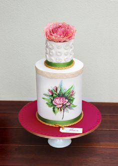 This has a couple of important cake trends: hand-painting and vintage. The gold edge on the flower, the buttons, the personal touches...all great.