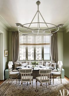 The dining room's Swedish neoclassical chairs are partnered with a 1970s Jansen table | archdigest.com