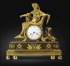A PATINATED AND GILT-BRONZE MANTEL CLOCK, EMPIRE