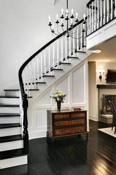 I like the black railing with white spindles Black And White Stairs, Black Railing, White Staircase, Staircase Design, White Walls, Black White, Grand Staircase, Stair Design, Curved Staircase