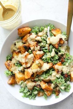 Potato Kale Bowls with Mustard Tahini Dressing - This Savory Vegan These Spicy Potato Kale Bowls with Mustard Tahini Dressing are the perfect Fall meal. Crispy potatoes, red onion, marinated kale and a delicious creamy dressing. Simple and healthy Fall Recipes, Whole Food Recipes, Kale Recipes Vegan, Simple Healthy Recipes, Healthy Dishes, Potato Recipes, Vegetable Recipes, Simple Vegan Meals, Entree Recipes