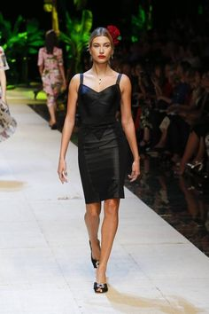 Dolce & Gabbana Spring 2017: Hailey Baldwin walks the runway in black dress with form-fitting silhouette