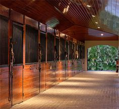 How impressive are these stables with beautiful timber features and cobble stone breezeway at two-swans-stables #stables
