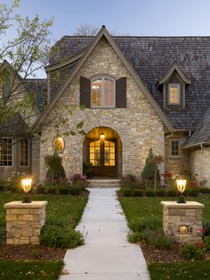 Love the colors - buff stone and slate roofing