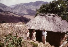 Family next to his house of straw in the mountainous area of Puerto Rico-1950's
