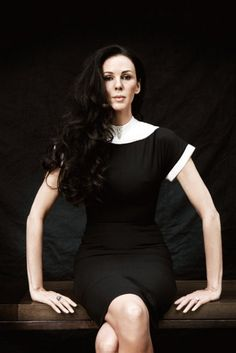 L'Wren Scott in her own design. The Headmistress dress, a simple figure-hugging black shift with spotless white collar popular with Madonna and Nicole Kidman, says it all – these were clothes that were sexy, but grownup and high-functioning.