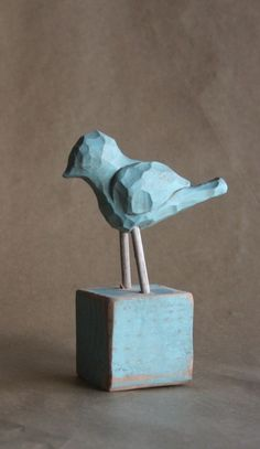 wood carved blue bird