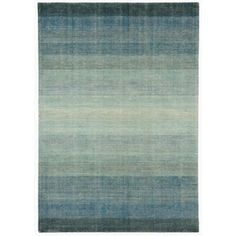 This 'Hays' rug is perfect for complementing elegant interiors. Hand-woven in a durable wool and cotton blend, it features a flat-weave finish and a wide striped design in subtle graduated blue tones.
