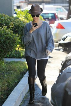 Kourtney Kardashian Casual Style- Feel the Piece sweater, Bluelab jeans, Gucci hat, Chanel boots and Benjamin sunglasses