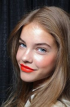 Add a pop of color to your prom makeup look with coral lips