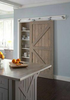 une belle porte en bois coulissante , murs gris pour la cuisine, salle a manger, idée