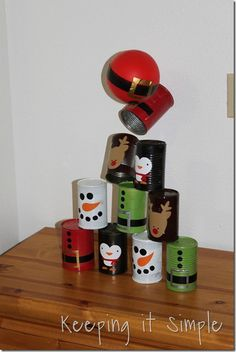 Christmas bowling cans by Keeping it Simple! Kids would LOVE this!