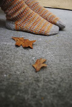 Cozying up to Autumn. Warm, colorful, seasonal socks worn while the fall leaves dance.