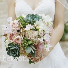Claudia held a rustic but romantic bouquet of Texas succulents and pink and white flowers. from the album: A Courtyard Wedding in Austin, TX