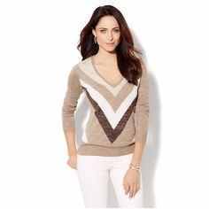 """New York & Co Luxe Waverly Lurex Chevron Sweater NWOT NY&Co's Luxe Waverly Lurex Sweater is sophisticated and flirty. Featuring a dramatic v-neck and stand-out, graphic chevron design, ribbed bottom band and sleeve cuff, plus a luxe glittering lurex knit fabric. Gives your wardrobe an instant style refresh. Measures 26"""" from shoulder to hem, 40"""" bust, waist, and hip. Constructed from 80% Acrylic, 13% Polyester, 7% Metallic. New York & Company Sweaters V-Necks"""