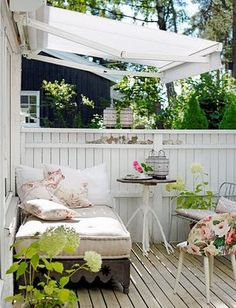 sweet daybed, lantern and awning in quaint backyard lounge
