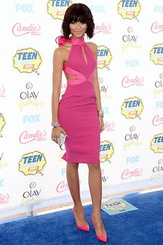 "Zendaya channeled Madonna's ""Material Girl"" in a bright pink halter neck dress custom-made by Material Girl with jewelry by Open Hearts by Jane Seymour at the 2014 Teen Choice Awards."