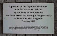 The plaque that is located on the right side of the façade