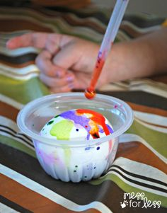 Liquid water color decorated eggs made with a dropper. Bright and vibrant colors and a fine motor activity for kids!