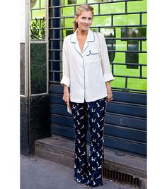 @Who What Wear - Wearing pajamas out of the house is totally acceptable, but only with heels.                 Photo via Stockholm Street Style