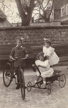 +~+~ Antique Photograph ~+~+ Children in their Sunday best posing on their toys.
