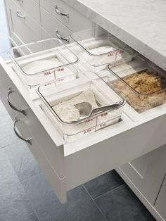 Flour and sugar drawer near cake mixer